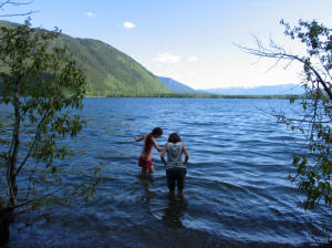 M&E wading in Lake McDonald